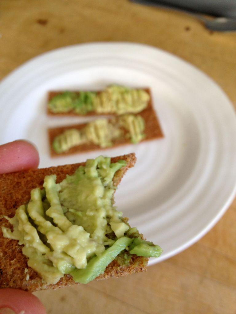 Rye crisps with avocado and sea salt.